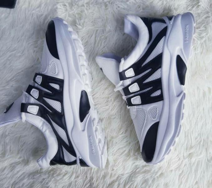 White sneakers with a touch of black :- color: white with a touch of b...