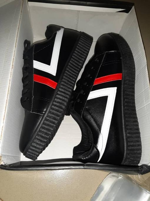 Black sneakers with a touch of white and red :- color: black with a touch of r...